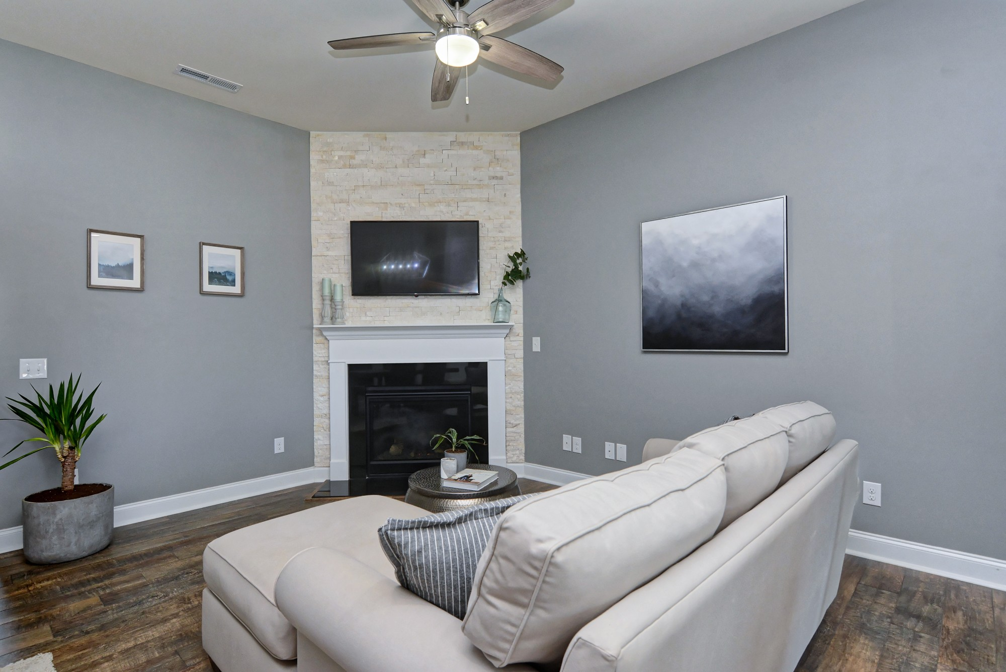 Living Area With Lighted Ceiling Fan